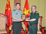 越南国防部副部长阮志咏会见中国驻越南使馆武官甄中兴