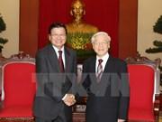 越共中央总书记阮富仲会见老挝外交部高级代表团
