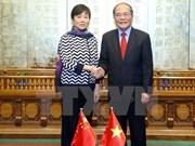 国会主席阮生雄会见中国人民对外友好协会会长李小林