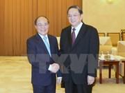 国会主席阮生雄会见中国政协主席俞正声