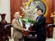 胡志明市市委书记丁罗升会见日本首相特别顾问饭岛勋