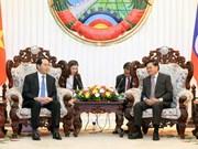 越南国家主席陈大光分别会见老挝总理与老挝国会主席