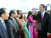 越南国家主席陈大光与旅居老挝占巴塞省越南人社群会面