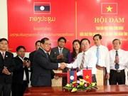 越南广治省劳动联合会与老挝沙湾拿吉省工会联合会举行会谈