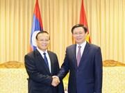 王廷惠副总理会见老挝财政部长宋迪·隆迪
