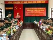 老挝凯山•丰威汉国防学院代表团访问政治军官学校