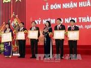 越南国家副主席邓氏玉盛出席越南经济技术工业大学成立60周年纪念典礼