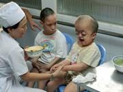 越南橙剂灾害57周年:缓解橙剂受害者的悲痛(组图)