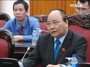 越南政府总理阮春福会见老挝计划与投资部部长苏潘·乔米赛