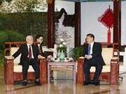 越中两党总书记进行茶叙(组图)