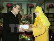 越南祖国阵线中央委员会主席阮善仁向释普惠老和尚拜年