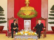 越共中央总书记阮富仲与越南国家主席陈大光会见印尼地方代表理事会主席乌斯曼