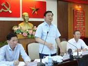 胡志明市委书记丁罗升与第二郡及第九郡郡委领导举行工作会谈