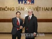 越通社社长阮德利会见法国新闻社首席执行官胡格