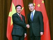 越南政府副总理兼外交部长范平明同中国外交部长王毅举行会谈