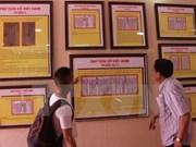 """""""黄沙和长沙归属越南:历史证据和法律依据""""地图资料图片展在乂安省举行"""