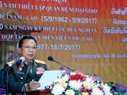 越老建交55周年:老挝国防部举行越老建交55周年纪念集会