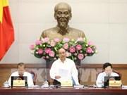 阮春福总理:政府及直属机构应继续与企业同行