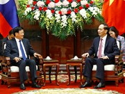 越南国家主席陈大光会见老挝总理通伦·西苏里