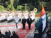 阮富仲举行仪式欢迎老挝人革党中央总书记、国家主席访越