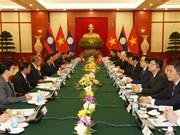 越共中央总书记阮富仲与老挝人民革命党中央委员会总书记、国家主席本扬举行会谈