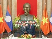 越南国家主席陈大光会见老挝人民革命党中央总书记、国家主席本扬·沃拉吉