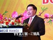 越南政府副总理范平明会见各国驻越外交使团代表