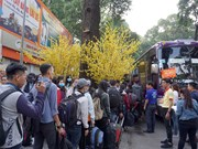 """胡志明市开启 """"春节班车""""活动 送数千名大学生回家过年"""