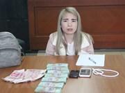 破获非法运输货币案 一名女嫌犯被捕
