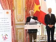 阮富仲总书记与法国国民议会议长共同出席越法建交45周年纪念典礼