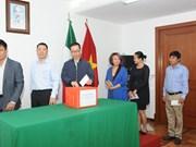 旅居墨西哥越南人为老挝水电站大坝坍塌受灾群众提供援助