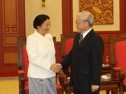 我国党和国家领导分别会见老挝国会主席