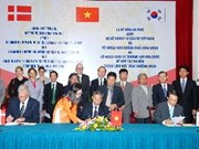 越韩丹签署绿色增长战略三方合作备忘录