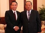老挝领导人接见越南通讯社高级代表团