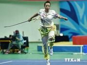 2014年仁川亚运会:越南武术选手杨翠薇为越南队摘下首枚金牌