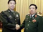 越南国防部代表团访华 双方草签设立保密直通电话备忘录