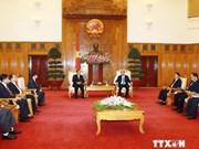 越南政府副总理阮春福会见老挝巴特寮通讯社高级代表团