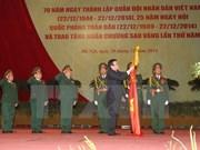 越南人民军建军70周年暨全民国防日25周年纪念典礼在河内隆重举行