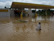 马来西亚北方遭数十年未见的大型洪水越南领导人致电慰问