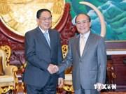 越南国会主席阮生雄礼节性拜访老挝国家主席朱马利